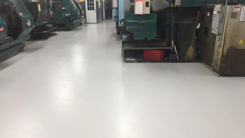 Industrial Floor Epoxy Repairs Oil-Soaked Machine Shop Floor